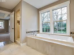 full bathroom with limestone tile floors u0026 drop in bathtub in