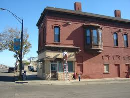 exterior painting old commercial brick building
