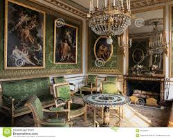 green room with furnitures and paintings at versailles palace