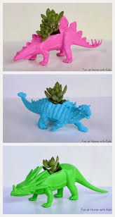 diy dinosaur planters for under five dollars