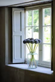 best 25 window sill ideas on pinterest window ledge window large cottage window with pale wooden shutters to top it of a clear large vase
