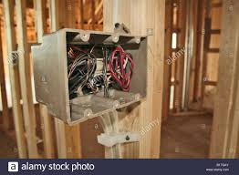 electrical outlet wiring in new home construction stock photo