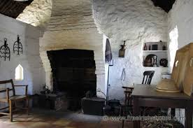 fireplace in old whitewashed irish cottage erin u0027s isle
