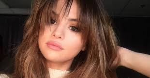 hair styles for square jaw large nose the best bangs for your face shape glamour