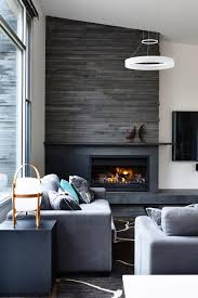 like the fireplace and the material surrounding it wood tile