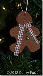 annawightcinn2660web400 chipboard ornament with cinnamon on top of