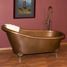 bathroom brown bathup with clawfoot tub on wooden floor for