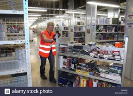 an amazon employee works inside the online seller u0027s new logistics