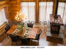 view from mezzanine of the wooden dining table with leather chairs