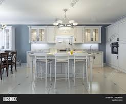 stainless steel kitchen appliances with white cabinets