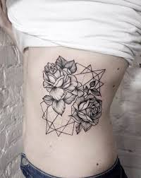 two dotwork roses on geometric patterns side tattoo amazing