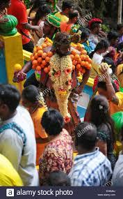 hindu garland hindu pilgrim with flower garland climbing the batu cave temple