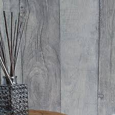 timber u0027 textured reclaimed washed wood plank effect wallpaper blue