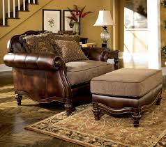 ashley furniture chair and ottoman claremore antique traditional two toned chair and 1 2 and ottoman