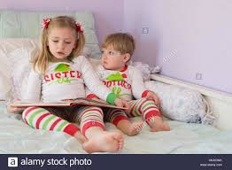 adorable and siblings reading story together