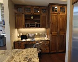 affordable custom cabinets showroom thumb kitchen shaker style knotty hickory dark color recessed panel wide frame glass on top of
