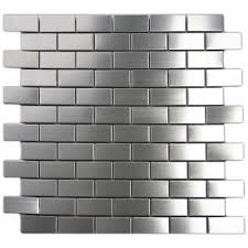 stainless steel 1x2 tile with white ceramic subway tile backsplash