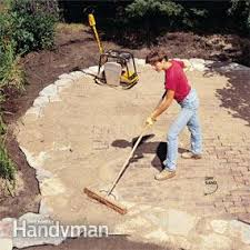 How To Make A Flagstone Patio With Sand Build A Stone Patio Or Brick Patio Family Handyman