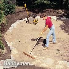 Building A Patio by Build A Stone Patio Or Brick Patio Family Handyman