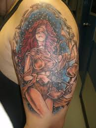 blind lady justice carrying a sword and scales tattoo design in