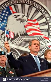 9 11 Remembrance Flag Us President George W Bush Holds Up A Small American Flag During