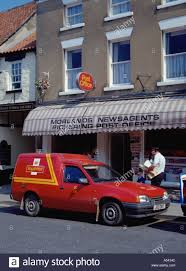 royal mail postal packet delivery a first class postal package rural post office postman delivery van and postman pat pickering north york