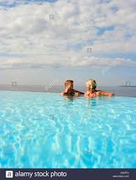 couple swimming in the overflow swimming pool hotel du cap eden