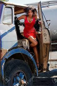 woman getting out of an old semi truck stock photo picture