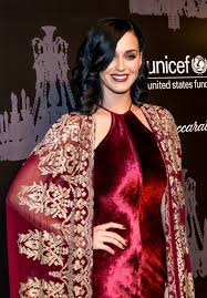 katy perry u0027s rose lipstick rose eyes red dress red cape and