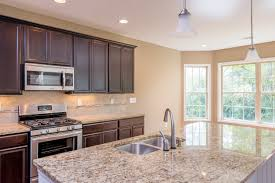 the kitchen of the hartford ii floor plan by ball homes the