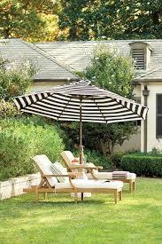 Striped Patio Umbrella 10 Ways To Make A Big Outdoor Statement Patio Umbrellas Patios