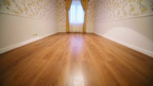 New Laminate Flooring Small Empty Room With Curtains On The Window And Laminate Floor In