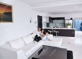 happy young couple relax at modern home living room indoor stock