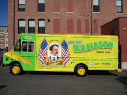 electric truck driving the big yellow wb mason e truck from workhorse gas2