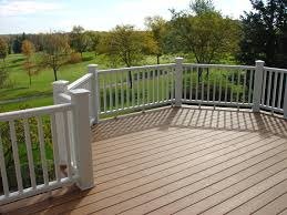 exterior decksouth trex transcend low with white wood deck
