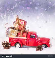 Vintage Ford Truck Gifts - old antique toy truck carrying christmas stock photo 222856510