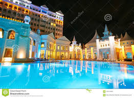 beautiful resort pool at night stock photo image 42675296