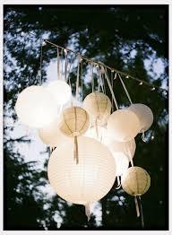 White Paper Lantern String Lights by Wedding Decor Paper Lanterns Hang From Light String Over Tables