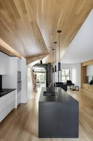 contemporary townhouse wooden surfaces connect living spaces in this montreal home built