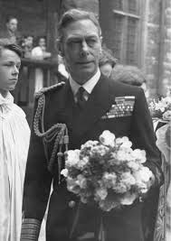 h m king george vi pictured receiving a bouquet of flowers 1951
