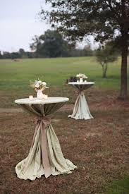 sage pintuck linens with burlap sashes on the cocktail tables i