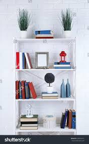 bookshelves books decorative objects on brick stock photo