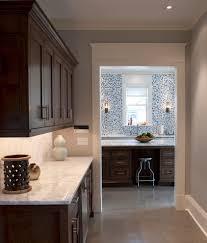 dark cabinets white backsplash kitchen eclectic with butler s