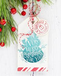 watercoloured holiday handmade card and stamped holiday tag by