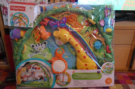 fisher price rainforest music and lights deluxe gym playset fisher price rainforest melodies and lights deluxe gym toys r us