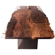 modern live edge bastogne walnut and glass dining table on