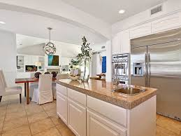 contemporary kitchen with travertine tile floors built in