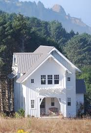 grey metal roof exterior farmhouse with board and batten arbors