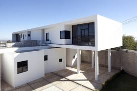 white style house modernist architecture in broken ceramic terrace