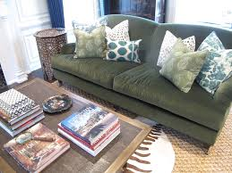living room olive green couch not our but in search of sage throw